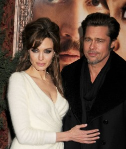 """All loved up! Angelina Jolie and Brad Pitt on the red carpet at the world premiere of """"The Tourist"""" at the Ziegfield Theater in New York"""
